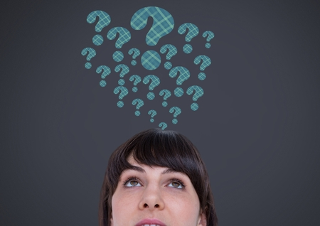 Digital composite of Woman with grey question marks emerging from head Stock Photo