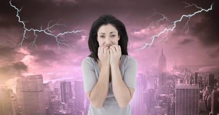 Digital composite of Lightning strikes and scared afraid woman