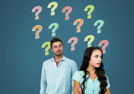 Digital composite of Confused unhappy couple with colorful funky question marks 写真素材