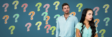 Digital composite of Confused unhappy couple with colorful funky question marks Stock Photo