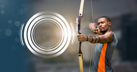 Digital composite of Archer man with bow and arrow and Glowing circle technology interface