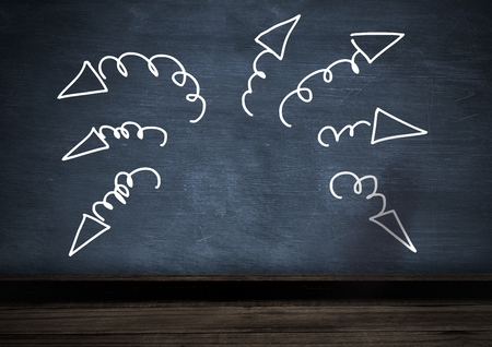 Digital composite of arrow squiggly doodles on blackboard