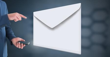 Digital composite of Envelope letter message and man using phone Reklamní fotografie