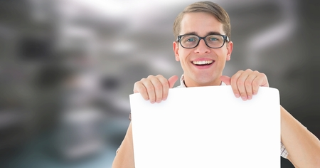 Digital composite of man holding card