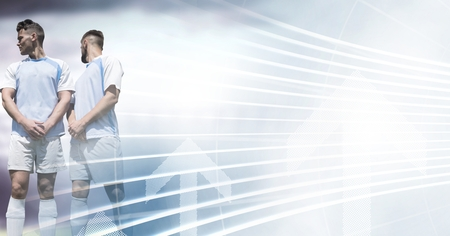 Digital composite of Soccer players in stadium light free kick wall