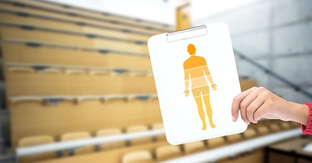Digital composite of Human Body sections and hand holding card in lecture