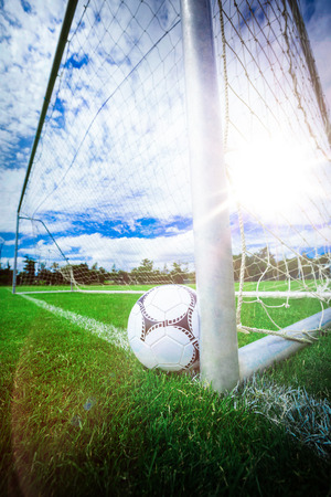 Soccer ball near a goal post in football stadium 版權商用圖片