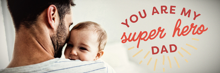 Close up of you are my super hero dad text against father holding his baby girl Stock Photo