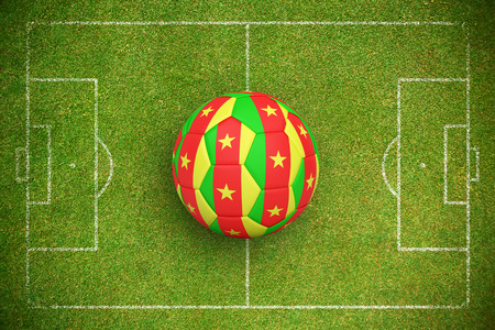 Football in cameroon colours against green background