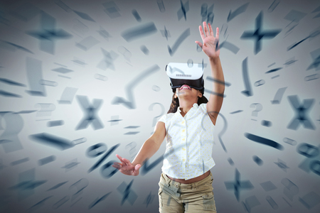 Girl wearing virtual reality simulator against grey vignette