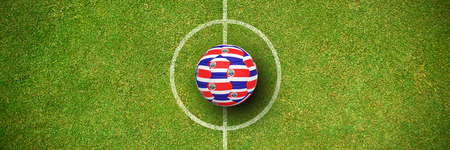Football in costa rica colours against green background