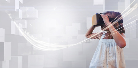 Girl wearing virtual reality simulator on white background Stock fotó