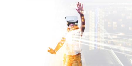 Girl wearing virtual reality simulator against white background