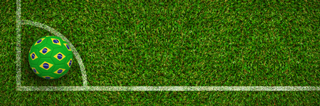 Football in brazilian colours against green grass Stock Photo