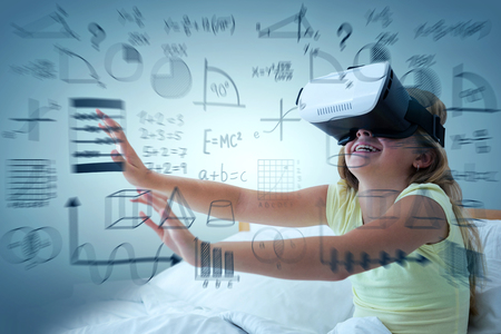 Girl wearing virtual reality simulator on bed against abstract green background,