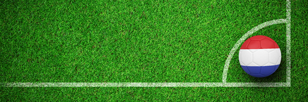 Football in holland colours against close up view of
