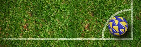 Football in bosnian colours against grass