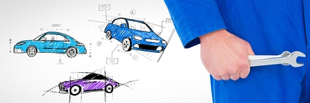 Digital composite of Mechanic holding wrench with sketch of cars hand drawing Stock Photo