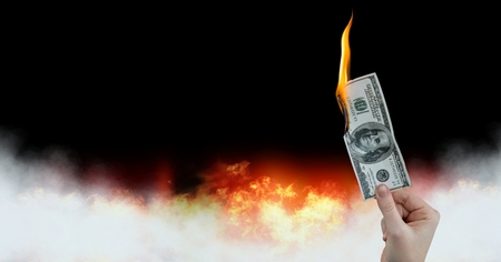 Digital composite of Dollar money note burning on fire Stock Photo