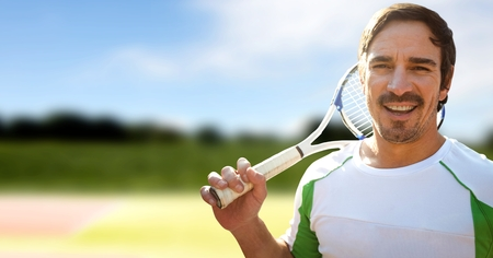 Digital composite of Tennis player man with green background with racket