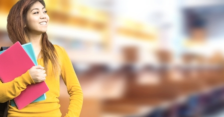 Digital composite of Happy student in education library