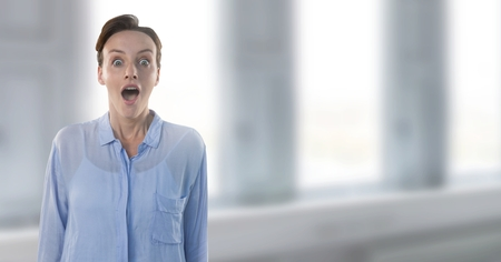 Digital composite of Businesswoman surprised by windows Stock Photo