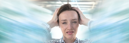 Digital composite of Businesswoman holding head stressed in work with motion effect