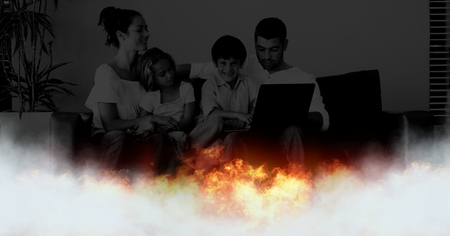 Digital composite of Family at home and burning fire