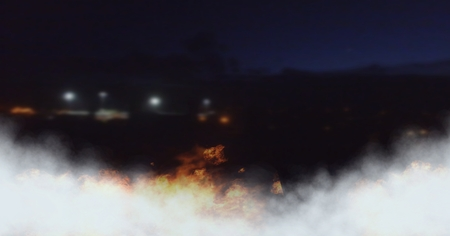 Digital composite of Night time with burning fire
