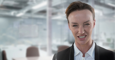 Digital composite of Mean and frustrated Businesswoman in office Banco de Imagens