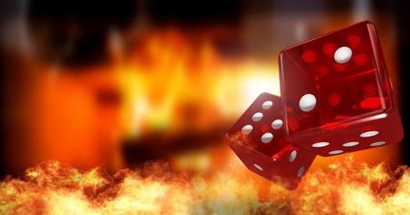 Digital composite of Red dice with burning fire