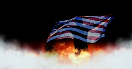 Digital composite of Patriotic Man holding America flag and burning fire Stock Photo