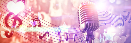 Close-up of microphone against digitally generated cool nightlife design with hearts and stars Stock Photo
