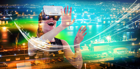 Illuminated harbor against cityscape against female executive using virtual reality headset