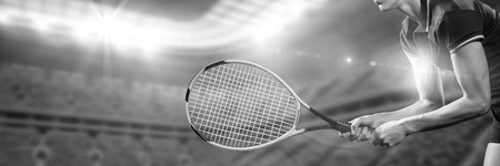 Digital composite of Black and white image of tennis player ready to play
