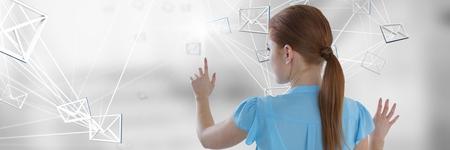 Digital composite of Composite image touching digital e-mail symbol