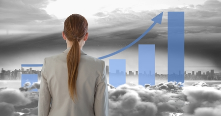 Digital composite of Composite image of woman looking at skyscraper with statistical graphs