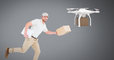 Digital composite of Man running with delivery parcel and drone Reklamní fotografie