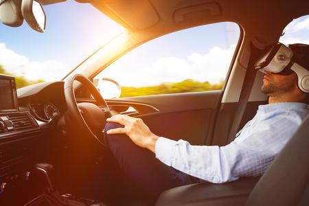 man behind the wheel wearing a virtual reality helmet