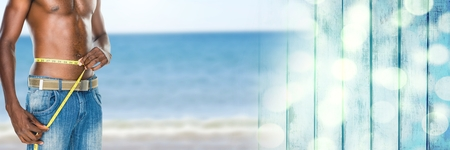 Digital composite of Man measuring weight with measuring tape on waist on Summer beach with transition