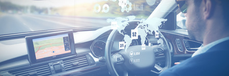 Global technology background against man behind the wheel wearing sunglasses Stockfoto
