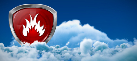 Red fire symbol against low angle view of white clouds against sky