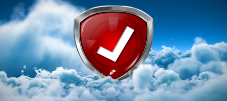 Red symbol validation against tranquil scene of overcast against sky