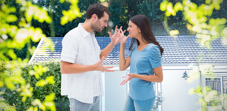 Angry brunette shouting at boyfriend against pretty house with a blue and white filter