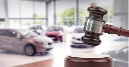 Digital composite of Gavel and cars auction Stock Photo
