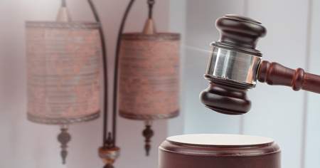 Digital composite of Gavel and antique lamps auction Stockfoto