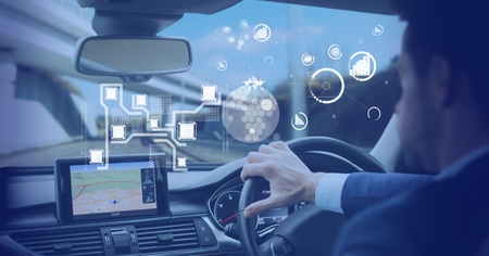 Digital composite of Man driving in car with heads up display interface