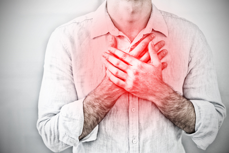 Mid section of a man with chest pain against highlighted pain