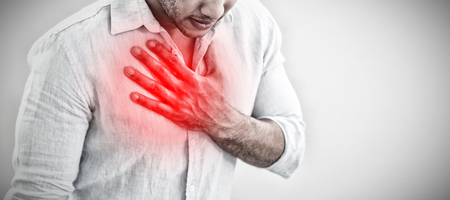 Casual young man with chest pain against highlighted pain