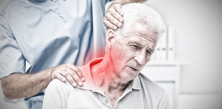 Highlighted pain against physiotherapist giving physical therapy to senior patient